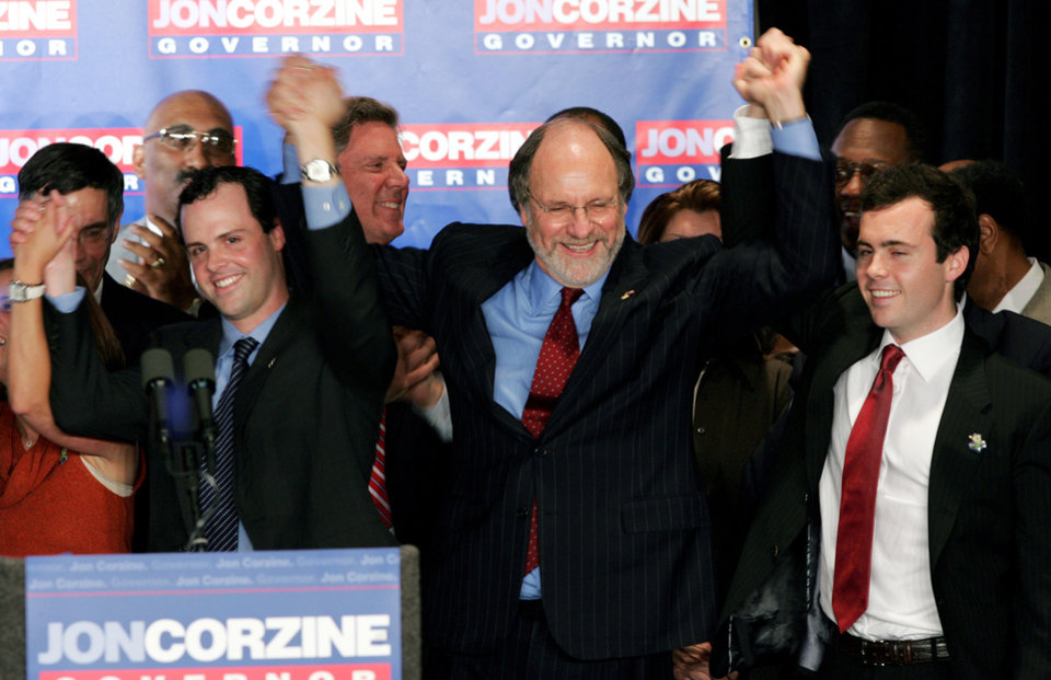 Photo - FILE - In this Nov. 8, 2005, file photo, gubernatorial candidate, Sen. Jon S. Corzine, D-N.J., center, celebrates with sons Joshua, left, and Jeffrey, right, in East Brunswick, N.J. According to a statement released by a spokesman for the former governor on Thursday, March 13, 2014, Jeffrey Corzine has died at age 31. There were no other details made available. (AP Photo/Mel Evans, File)