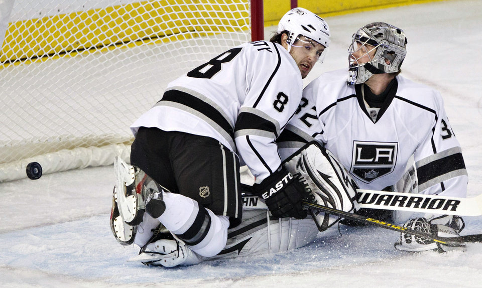 Los Angeles Kings' Drew Doughty (8) and goalie Jonathan Quick look for the rebound on a shot from the Edmonton Oilers during the first period of their NHL hockey game, Tuesday, Feb. 19, 2013, in Edmonton, Alberta. (AP Photo/The Canadian Press, Jason Franson)