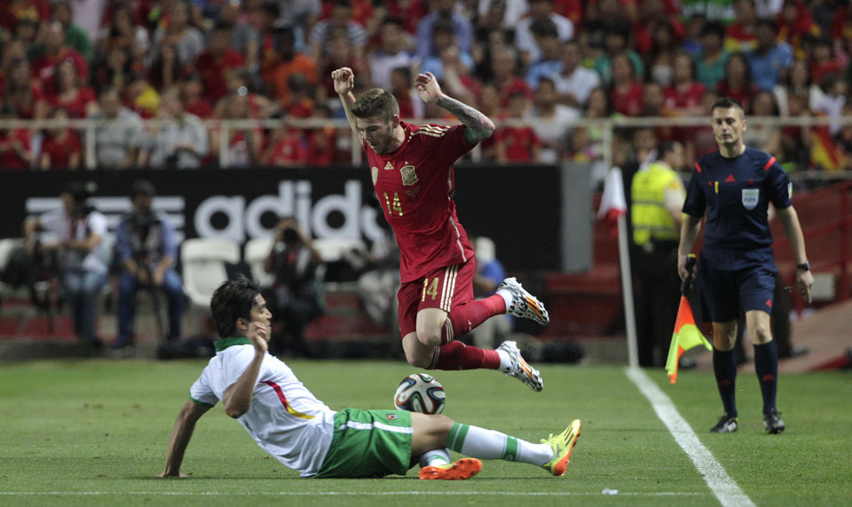 Photo - Spain's Fernando Torres, right, and Bolivia's Ronald Equino, left, vie for the ball during their friendly soccer match in Seville, on Friday, May 30. 2014. (AP Photo/Miguel Angel Morenatti)