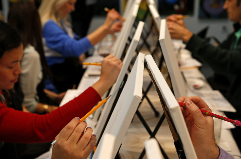 Photo - Students sketch during a class at Wine & Palette in Oklahoma City, Tuesday, Dec. 11, 2012. Photo by Bryan Terry, The Oklahoman