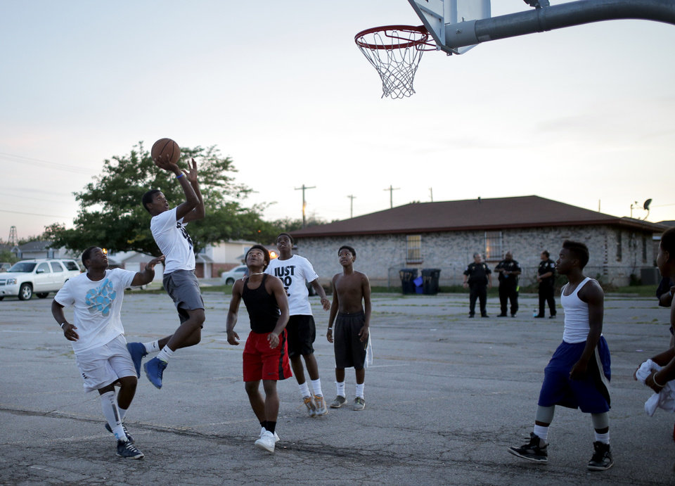 Photo - Youth play basketball during midnight basketball at Christ Temple Community Church in Oklahoma City, Friday, Aug. 1, 2014. Photo by Sarah Phipps, The Oklahoman