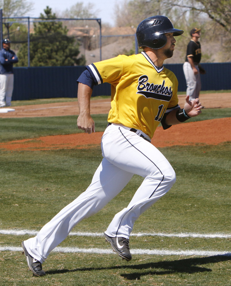 Photo - UCO senior Tyler Crabtree heads toward first base during a game at the University of Central Oklahoma in Edmond, OK, Friday, April 4, 2014. He was hit by pitches an NCAA Division II record 41 times last season.  Photo by Paul Hellstern, The Oklahoman