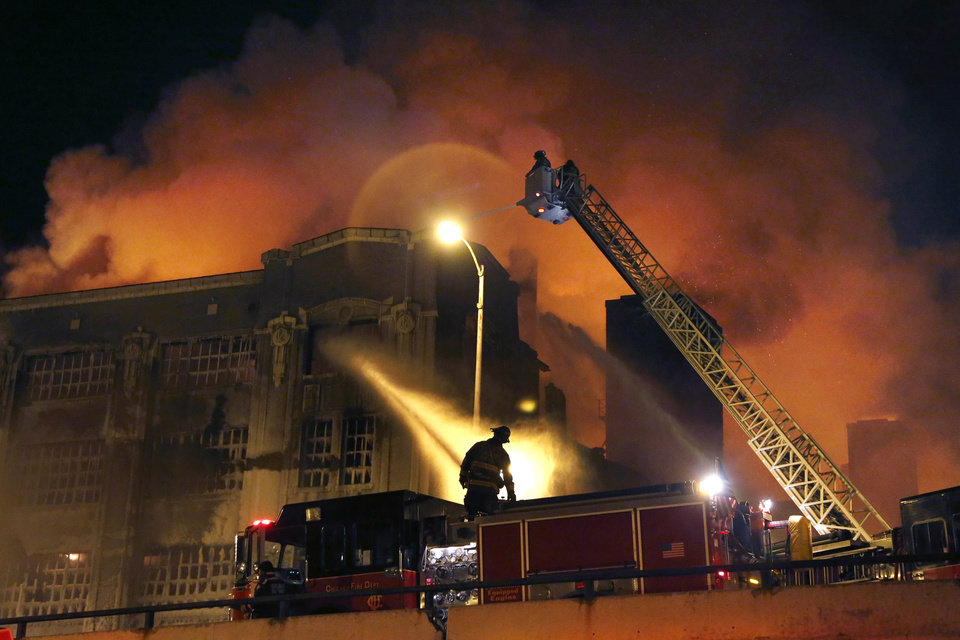 Chicago firefighters battle a five-alarm blaze in single digit temperatures at a warehouse on the city's South Side, Bridgeport neighborhood Wednesday, Jan. 23, 2013, in Chicago. (AP Photo/Charles Rex Arbogast)