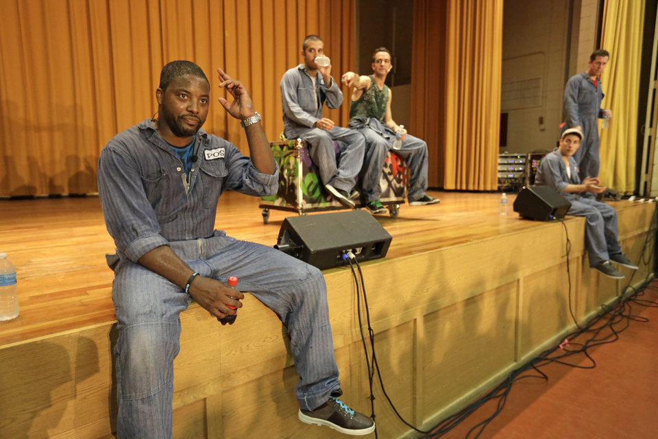 Photo - In this Aug. 27, 2013, photo, from left, rappers Postell Pringle, JQ and GQ, DJ Clayton Stamper, and rapper Jackson Doran take questions from the audience at the Cook County Jail after performing a 70 minute hip hop adaptation of William Shakespeare's Othello, titled