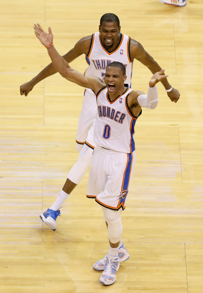 Photo - Oklahoma City's Russell Westbrook (0) and Kevin Durant (35) celebrate after winning Game 5 of the Western Conference semifinals in the NBA playoffs between the Oklahoma City Thunder and the Los Angeles Clippers at Chesapeake Energy Arena in Oklahoma City, Tuesday, May 13, 2014. Photo by Bryan Terry, The Oklahoman