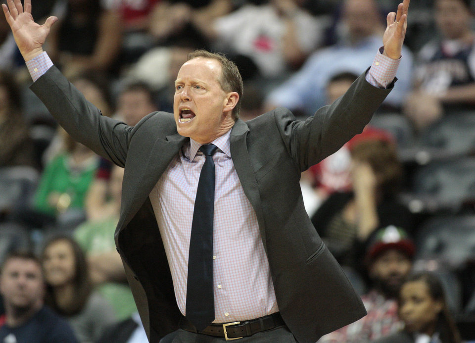 Photo - Atlanta Hawks head coach Mike Budenholzer argues a call with a referee in the first half of an NBA basketball game against the Philadelphia 76ers Monday, March 31, 2014, in Atlanta. (AP Photo/Jason Getz)