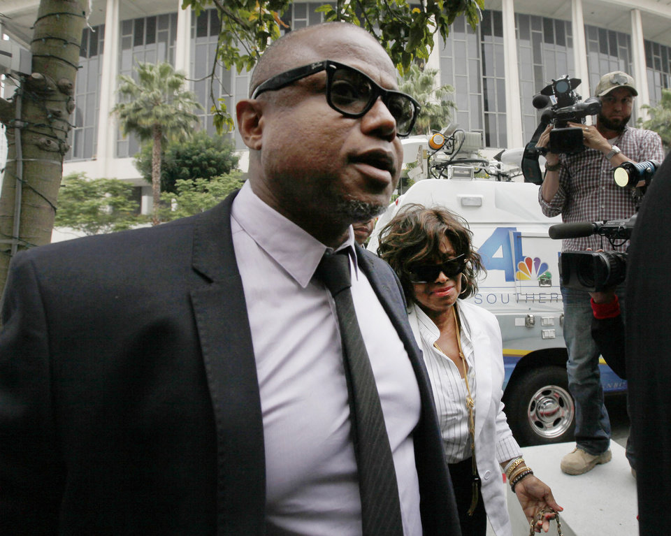 Photo - Randy Jackson and Rebbie Jackson, background right, brother and sister of late pop star Michael Jackson, arrive at a courthouse for Katherine Jackson's lawsuit against concert giant AEG Live in Los Angeles, Monday, April 29, 2013. An attorney for Michael Jackson's mother says AEG Live owed it to the pop superstar to properly investigate the doctor held criminally responsible for his death. (AP Photo/Nick Ut)