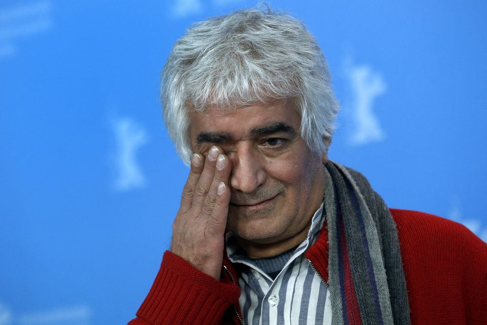 Photo - Co-director Kamboziya Partovi  gestures  during the photo call of the film Closed Curtain at the 63rd edition of the Berlinale, International Film Festival in Berlin, Germany, Tuesday, Feb. 12, 2013. (AP Photo/Michael Sohn)