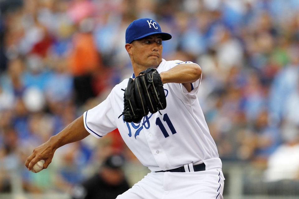 Photo - Kansas City Royals pitcher Jeremy Guthrie throws to a batter in the first inning of a baseball game against the the Los Angeles Dodgers at Kauffman Stadium in Kansas City, Mo., Monday, June 23, 2014. (AP Photo/Colin E. Braley)