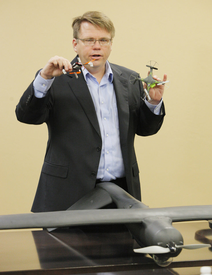 Photo -  James Grimsley, president and CEO of Design Intelligence Incorporated, talks about drone research and development in Oklahoma during a meeting at the Tinker Business and Industrial Park Monday, April 28, 2014. On the table is a MK4 model drone used in wind tunnel tests. Photo by Paul B. Southerland, The Oklahoman   PAUL B. SOUTHERLAND -  PAUL B. SOUTHERLAND