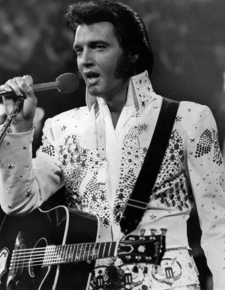 Photo -   FILE - In this undated file photo released by NBC-TV, singer Elvis Presley is shown in concert in the later part of his career. Presley's estate announced it has authorized holograms of the King of Rock, Marilyn Monroe's estate has expressed interest and there's no shortage of other beloved stars whose fans would die to see them perform again. (AP Photo/NBC-TV, FILE)