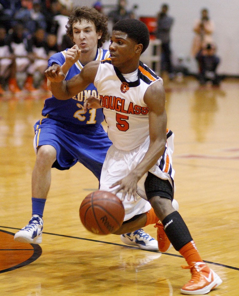 Stephen Clark of Douglass goes past Piedmont's Tanner Larson during a Class 4A boys basketball state tournament game in Midwest CIty, Okla., Thursday, March 8, 2012. Photo by Bryan Terry, The Oklahoman