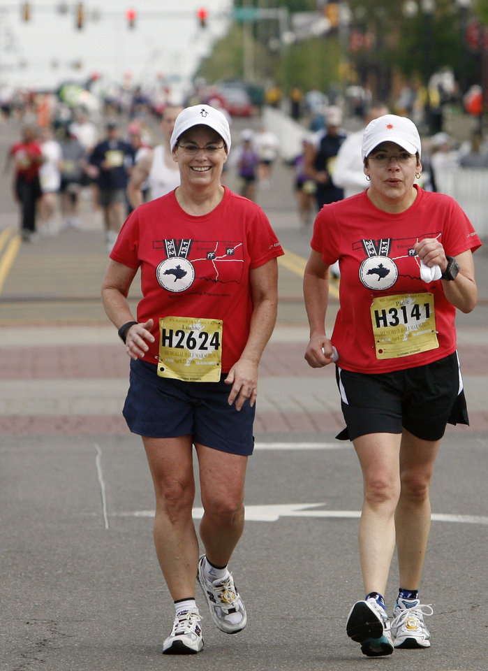 Marathon runners Luanne Hale and Patricia Jarolim, from left, make their way down the final stretch to the finish line during the eighth annual Oklahoma City Memorial Marathon on Sunday , April 27, 2008, in Oklahoma City, Okla.   PHOTO BY CHRIS LANDSBERGER   ORG XMIT: KOD