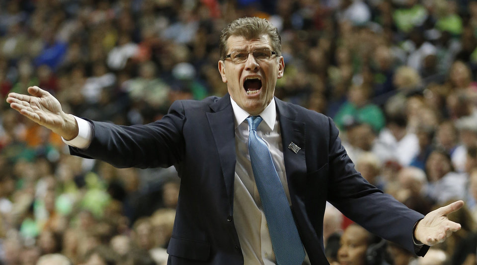 Photo - Connecticut head coach Geno Auriemma speaks to an official during the first half of the semifinal game against Stanford in the Final Four of the NCAA women's college basketball tournament, Sunday, April 6, 2014, in Nashville, Tenn. (AP Photo/John Bazemore)