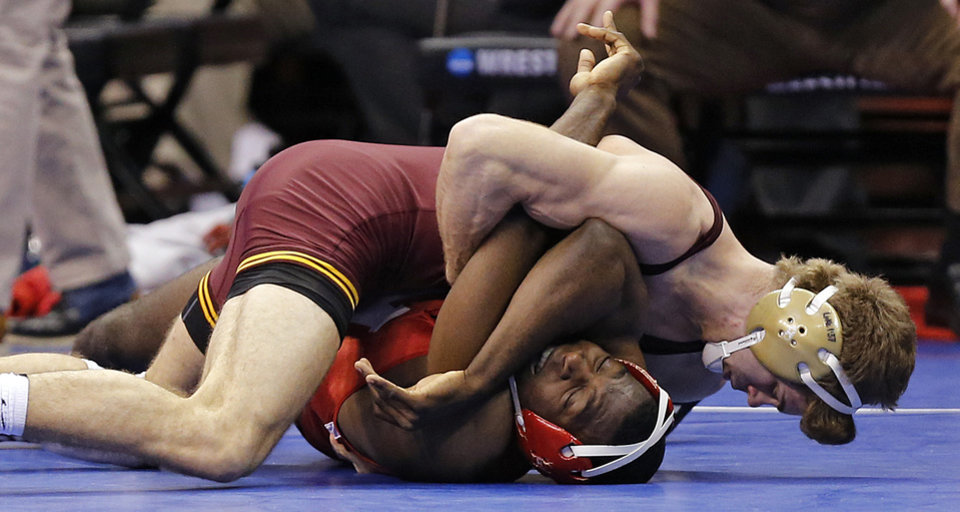 Photo - Minnesota's Dylan Ness pins the number one seed of Nebraska's James Green in the 157 pound match during the 2014 NCAA Div. 1 Wrestling Championships at Chesapeake Energy Arena in Oklahoma City, Okla. on Friday, March 21, 2014. Photo by Chris Landsberger, The Oklahoman