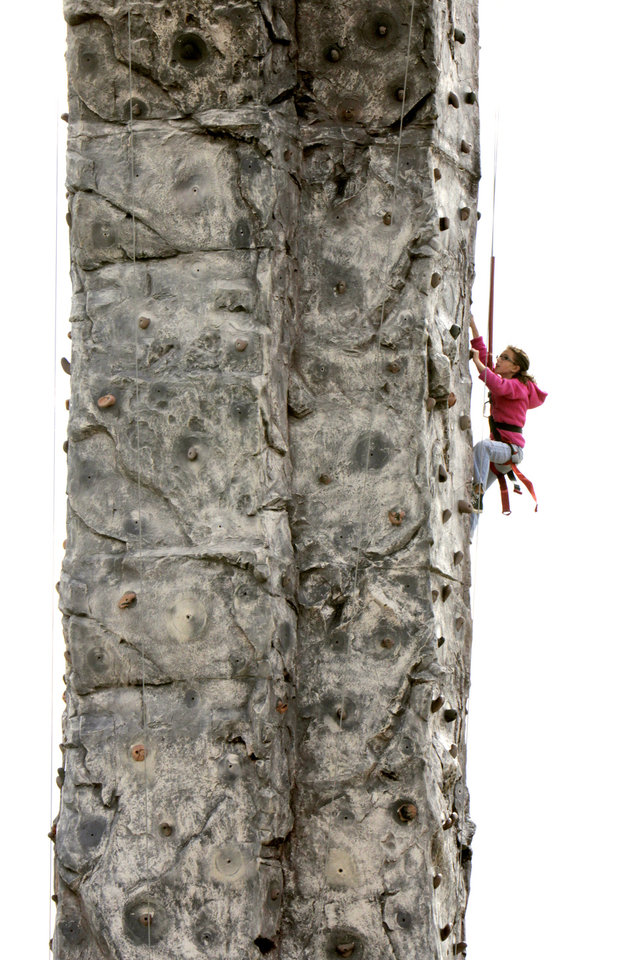 Ten-year-old Megan Plumley climbs the side of a tower during a community fair at Andy\'s Alligator Park in Norman, OK, Saturday, Nov. 12, 2011. By Paul Hellstern, The Oklahoman