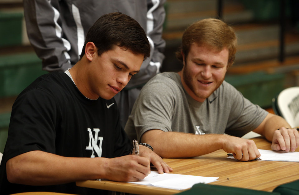 Baseball players D. J. Gasso, left, and Luke Jones sign letters of intent to play at Weatherford, Texas Junior College at a signing day assembly at Norman North High School on Wednesday, Feb. 6, 2013, in Norman, Okla. Photo by Steve Sisney, The Oklahoman