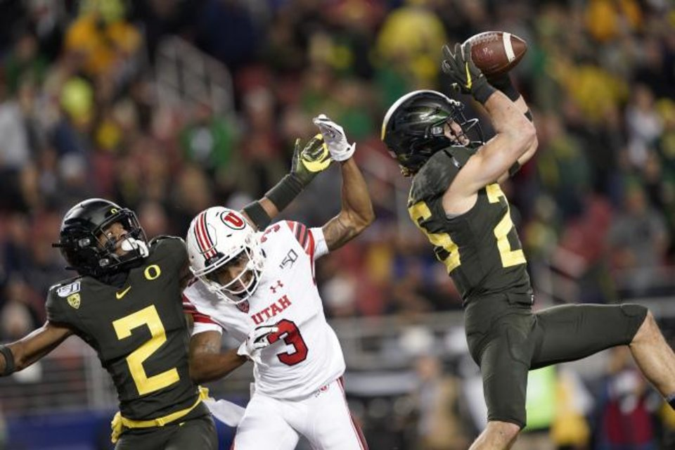 Photo -  Oregon safety Brady Breeze, right, intercepts a pass intended for Utah wide receiver Demari Simpkins (3) as Oregon cornerback Mykael Wright (2) defends during the first half of the Pac-12 championship Friday in Santa Clara, Calif. [AP Photo/Tony Avelar]