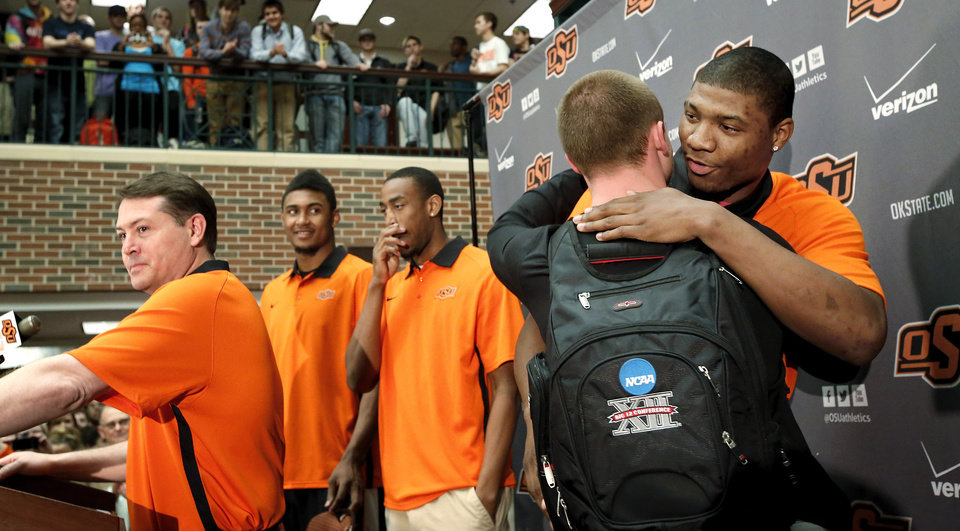 Photo -  OSU basketball players Le'Bryan Nash, Markel Brown and Marcus Smart delighted  fans when they announced at a noontime press conference they intend to return for another season as members of the Cowboys basketball team. Cheering fans lined all levels in the Student Union atrium Wednesday, April 17, 2013.    by Jim Beckel, The Oklahoman.