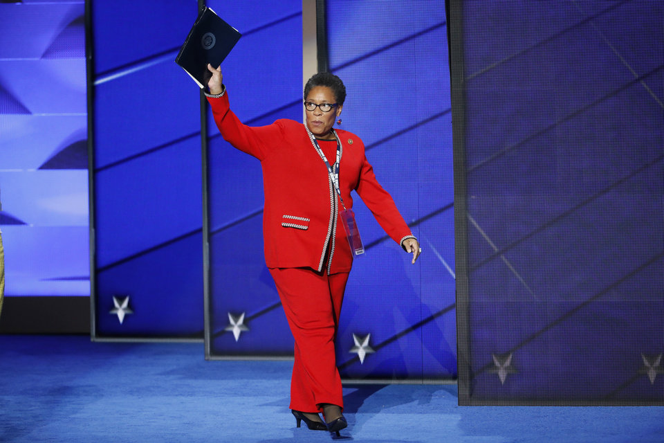 Photo - Rep. Marcia Fudge, D-Ohio, Chair, Democratic National Convention wave as she walks on stage during the first day of the Democratic National Convention in Philadelphia , Monday, July 25, 2016. (AP Photo/J. Scott Applewhite)