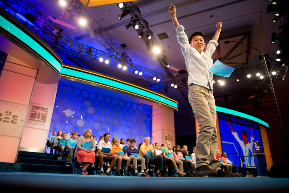 "Photo - Nicholas Lee, 11, of Diamond Bar, Calif. reacts as he correctly spelled ""buisson"" during the 2015 Scripps National Spelling Bee, Wednesday, May 27, 2015, in Oxon Hill, Md. (AP Photo/Andrew Harnik)"