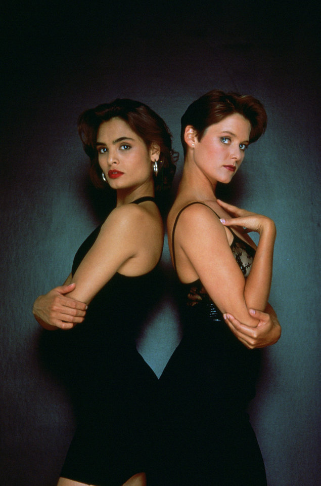 "This undated publicity photo provided by United Artists and Danjaq, LLC shows Talisa Soto, left, and Carey Lowell in the James Bond 1989 film, ""Licence to Kill."" Always glamorous and sophisticated, yet uniquely susceptible to James Bond's flirtations, the Bond girl over the years has become as compelling as Agent 007 himself, and not just for the way she fills out a swimsuit. The film is included in the MGM and 20th Century Fox Home Entertainment Blu-Ray ""Bond 50"" anniversary set. (AP Photo/United Artists and Danjaq, LLC)"