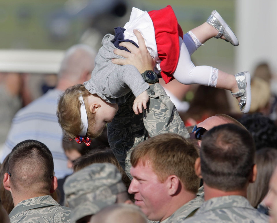 MILITARY DEPLOYMENT: Members of 138th Fighter Wing of the Oklahoma Air National Guard say goodbye to their famiies before boarding a plane for deployment from Tulsa, OK Sept. 28, 2011, to Iraq to help support the drawn down of forces. MICHAEL WYKE/Tulsa World