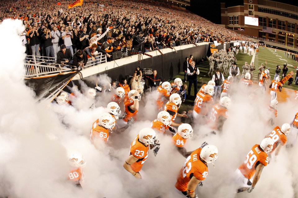 Cowboys take the field during the college football game between the Oklahoma State University Cowboys (OSU) and the University of Texas Longhorns (UT) at Boone Pickens Stadium in Stillwater, Okla., Saturday, Oct. 31, 2009. Photo by Doug Hoke, The Oklahoman