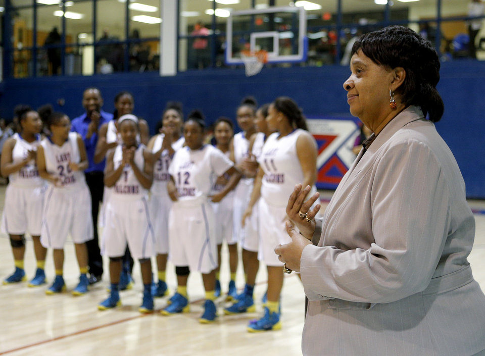 Photo - Longtime Millwood girls basketball coach Arnelia Spears stands in front of her team as she is honored following her last regular season home game at Millwood in Oklahoma City, Tuesday, Feb., 11, 2014. Photo by Bryan Terry, The Oklahoman