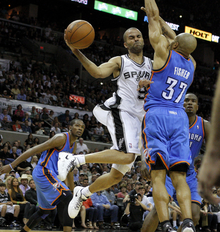 San Antonio's Tony Parker (9) passes the ball around Oklahoma City's Derek Fisher (37) during Game 2 of the Western Conference Finals between the Oklahoma City Thunder and the San Antonio Spurs in the NBA playoffs at the AT&T Center in San Antonio, Texas, Tuesday, May 29, 2012. Oklahoma City lost 120-111. Photo by Bryan Terry, The Oklahoman