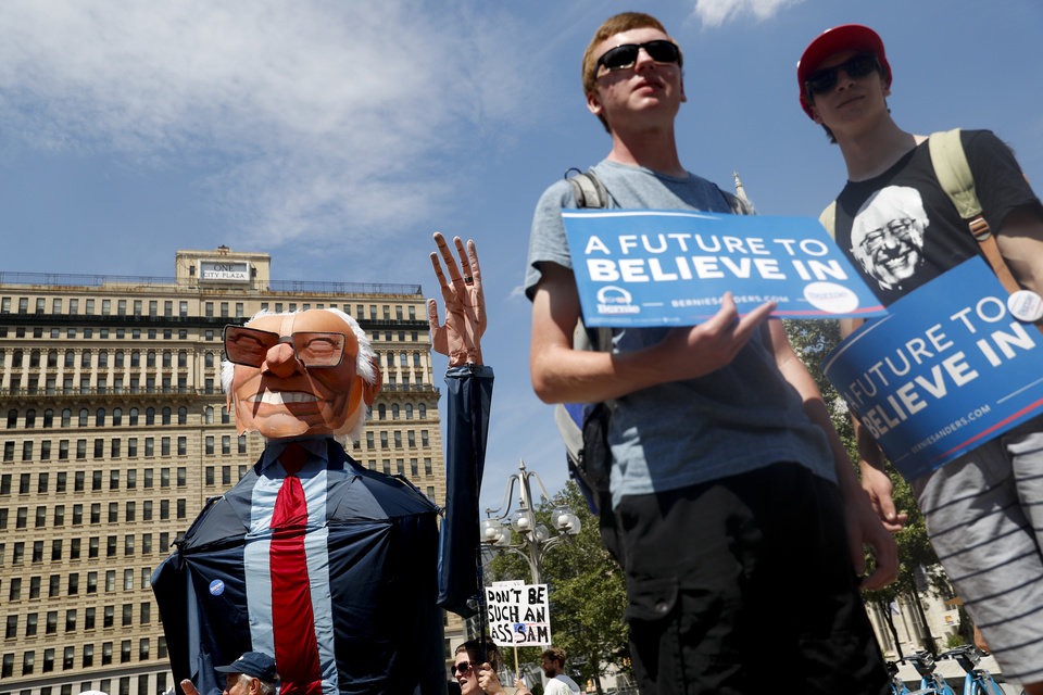 Photo - Supporters of Sen. Bernie Sanders, I-Vt., marches during a protest in downtown on Sunday, July 24, 2016, in Philadelphia. The Democratic National Convention starts Monday in Philadelphia. (AP Photo/John Minchillo)