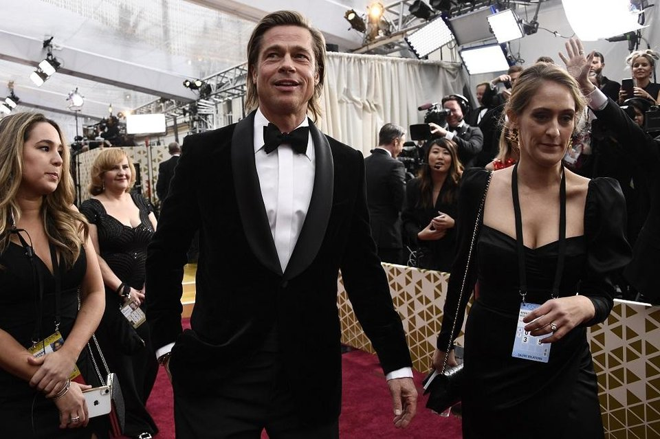 Photo - Brad Pitt arrives at the 92nd Academy Awards at Dolby Theatre. [Robert Hanashiro/USA TODAY]