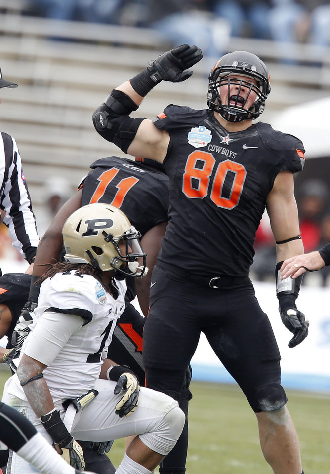 Photo - COLLEGE FOOTBALL / BOWL GAME / CELEBRATION: Oklahoma State's Cooper Bassett (80) celebrates a fumble recovery in front of Purdue's Tommie Thomas (12) during the Heart of Dallas Bowl football game between Oklahoma State University (OSU) and Purdue University at the Cotton Bowl in Dallas,  Tuesday,Jan. 1, 2013. Photo by Sarah Phipps, The Oklahoman