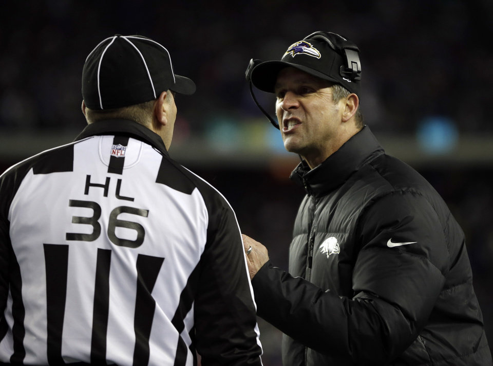 Baltimore Ravens head coach John Harbaugh, right, talks to head linesman Tony Veteri, left, during the first half of the NFL football AFC Championship football game in Foxborough, Mass., Sunday, Jan. 20, 2013. (AP Photo/Matt Slocum)