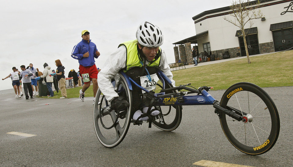 Photo - Wheelchair marathon participant goes past the water station at Lake Hefner during the eighth annual Oklahoma City Memorial Marathon on Sunday , April 27, 2008, in Oklahoma City, Okla.   PHOTO BY CHRIS LANDSBERGER   ORG XMIT: KOD