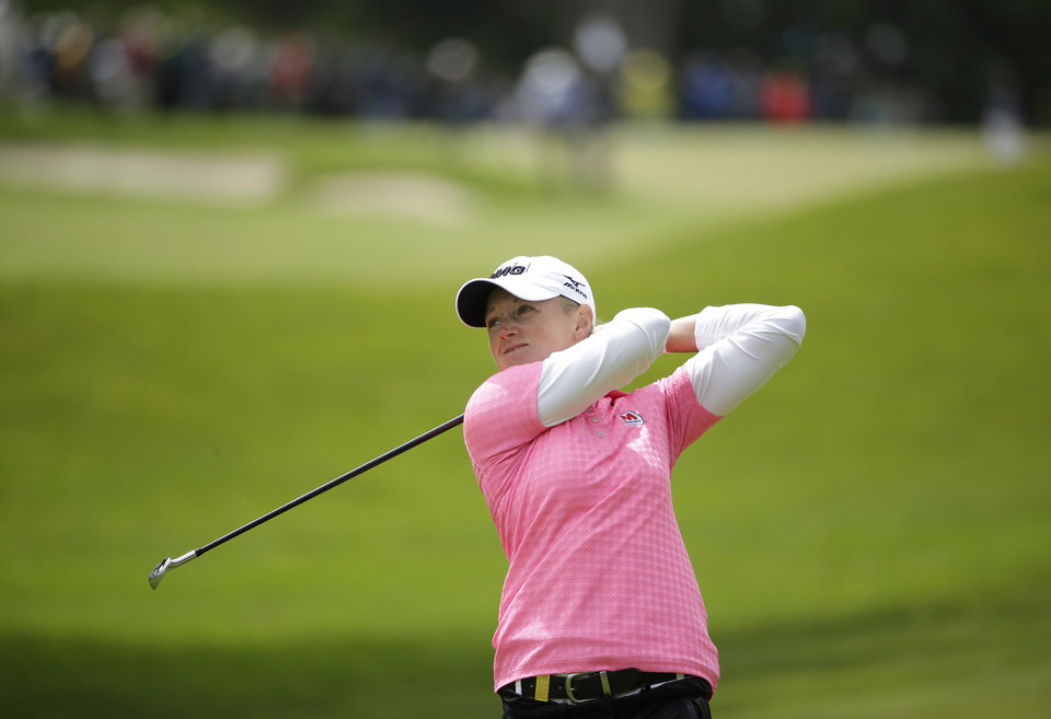 Photo - Stacy Lewis hits from the fourth fairway of the Lake Merced Golf Club during the third round of the Swinging Skirts LPGA Classic golf tournament on Saturday, April 26, 2014, in Daly City, Calif. (AP Photo/Eric Risberg)