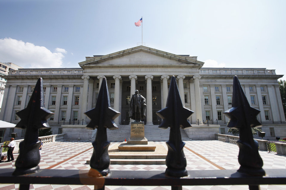 FILE - In this Aug. 8, 2011 file photo, a statue of former Treasury Secretary Albert Gallatin stands outside the Treasury Building in Washington. The Treasury Department releases federal budget data for May on Wednesday, June 11, 2014. (AP Photo/Jacquelyn Martin, File)