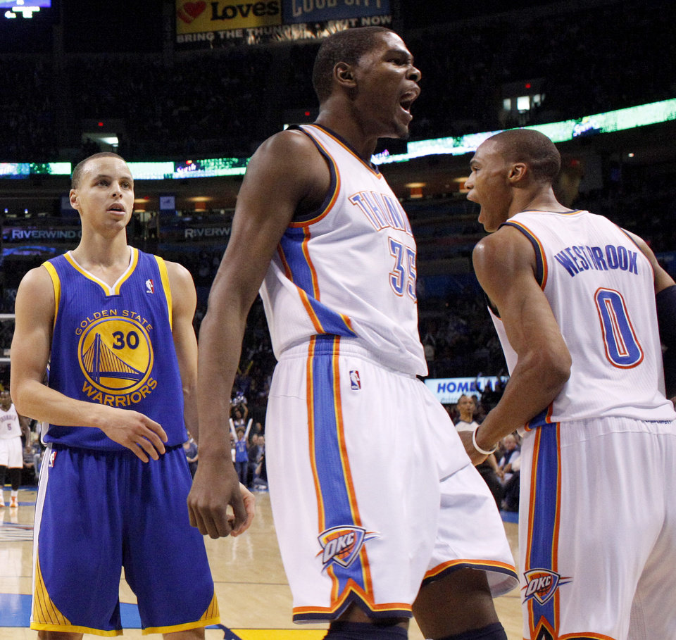 Oklahoma City's Kevin Durant (35) reacts beside City's Russell Westbrook (0) and Golden State's Stephen Curry (30) during the NBA basketball game between the Oklahoma City Thunder and the Golden State Warriors at the Oklahoma City Arena, Tuesday, March 29, 2011. Photo by Bryan Terry, The Oklahoman