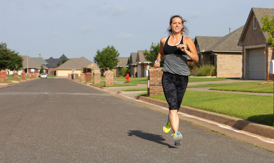 Photo - Katie Russell, Oklahoma City, photographed Wednesday, June 18, 2014, running in Oklahoma City in her bright neon yellow running shoes. Katie will run from Tulsa to Oklahoma City next week to raise awareness for Water4.  Water4's mission is to eradicate the world's water crisis in an effort to make clean water realistic for even the most remote areas. Photo by Paul B. Southerland, The Oklahoman