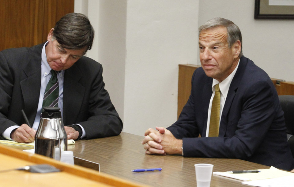 Photo - Former San Diego Mayor Bob Filner, right, sits with counsel in court before he pleads guilty on state charges of felony false imprisonment Tuesday, Oct. 15, 2013 in San Diego. Filner pleaded guilty to one criminal count of false imprisonment by violence, fraud, menace and deceit and two misdemeanor counts of battery. The charges involve three unnamed women victims. Filner, 71, resigned in late August, succumbing to intense pressure after at least 17 women brought lurid sexual harassment allegations. (AP Photo/UT-San Diego, John Gibbins)  NO SALES; COMMERCIAL INTERNET OUT