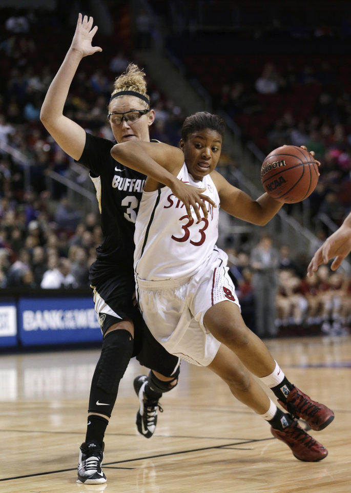 Stanford's Amber Orrange (33) tries to drive past Colorado's Jen Reese during the first half of an NCAA college basketball game in the Pac-12 Conference tournament Saturday, March 9, 2013, in Seattle. (AP Photo/Elaine Thompson)