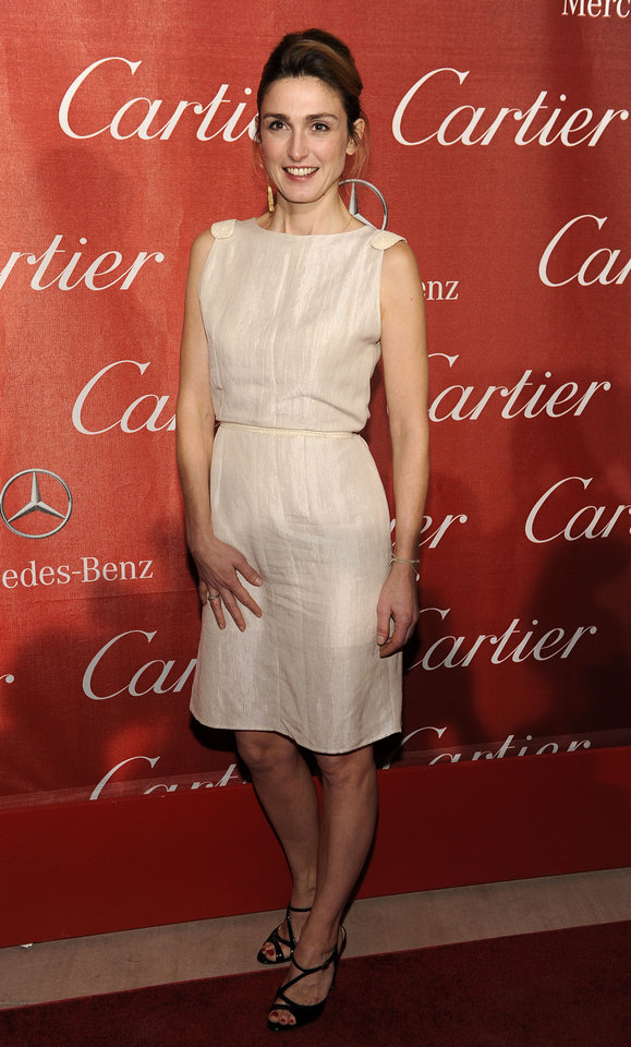 Photo - FILE - In this Jan.7, 2012 file photo, French actress Julie Gayet poses at the 2012 Palm Springs International Film Festival Awards Gala, in Palm Springs, Calif. French President Francois Hollande is threatening legal action over magazine report saying on Friday Jan.10, 2014 that he is having a secret affair with the French actress. Rumors have long circulated that Hollande might have a lover. The magazine Closer published images Friday showing his bodyguard and a helmeted man it says is Hollande visiting what it says is the apartment of the actress. (AP Photo/Chris Pizzello, File)