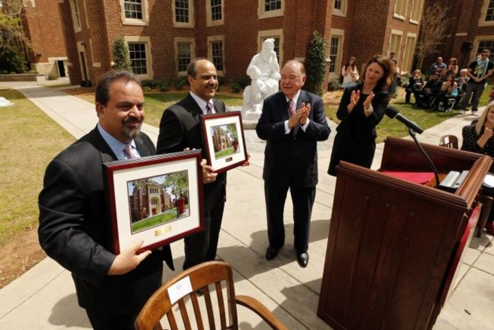 Photo -  Brothers Mohammad and Jalal Farzaneh, owners of Home Creations, are applauded by then University of Oklahoma President David Boren and then Dean Suzette Grillot (still on faculty) as they announce a gift to benefit the College of International Studies and unveil a sculpture titled Omar Khayyam, in back, by internationally noted Iranian sculptor Professor Hossein Fakhimi on March 30, 2016, in Norman. [THE OKLAHOMAN ARCHIVES]
