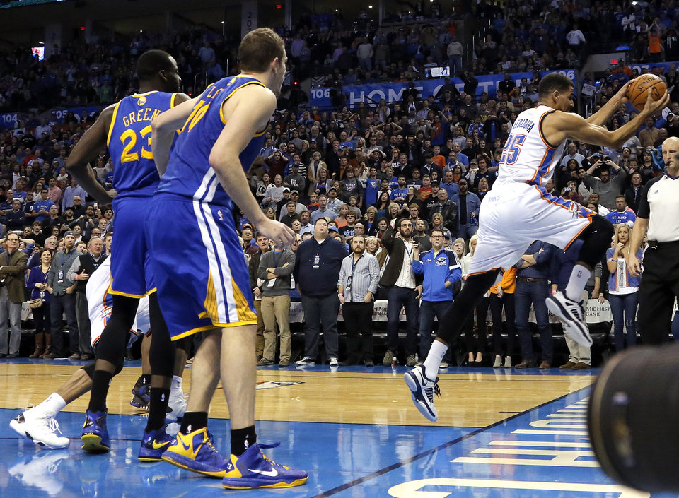 Photo - Oklahoma City's Thabo Sefolosha (25) saves a ball from going out of bounds during overtime of the during the NBA game between the Oklahoma City Thunder and the Golden State Warriors at the Chesapeake Energy Arena, Friday, Nov. 29, 2013. Photo by Sarah Phipps, The Oklahoman
