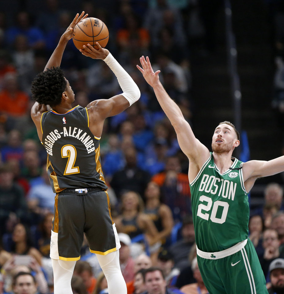 Photo - Oklahoma City's Shai Gilgeous-Alexander (2) shoots over Boston's Gordon Hayward (20) in the first quarter during an NBA basketball game between the Oklahoma City Thunder and the Boston Celtics at Chesapeake Energy Arena in Oklahoma City, Sunday, Feb. 9, 2020. [Nate Billings/The Oklahoman]