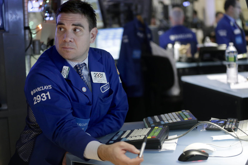 In this Friday, Dec. 28, 2012, photo, a trader works on the floor at the New York Stock Exchange in New York. Wall Street stocks tumbled on Thursday Jen. 3. 2013 after a transcript of the last meeting of the U.S. Federal Reserve unveiled a divided opinion among central bankers over how long the Fed should keep buying bonds to support the economy. (AP Photo/Seth Wenig)