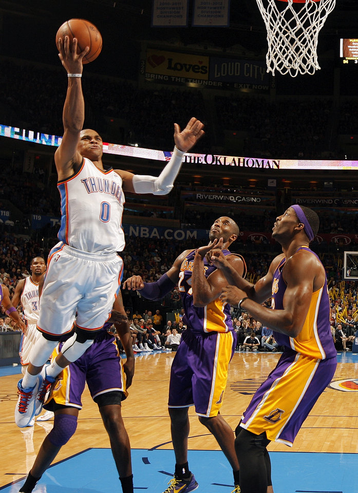 Photo - L.A. LAKERS / NBA / OKLAHOMA CITY THUNDER BASKETBALL: Oklahoma City's Russell Westbrook (0) takes the ball to the hoop over Los Angeles' Kobe Bryant (24) and Dwight Howard (12) during an NBA basketball game between the Oklahoma City Thunder and the Los Angeles Lakers at Chesapeake Energy Arena in Oklahoma City, Friday, Dec. 7, 2012. Oklahoma City won, 114-108. Photo by Nate Billings, The Oklahoman