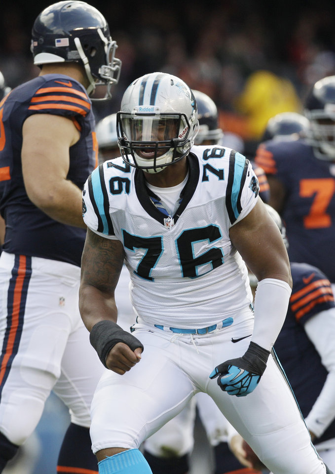 Photo -   Carolina Panthers defensive end Greg Hardy (76) reacts after sacking Chicago Bears quarterback Jay Cutler in the first half of an NFL football game in Chicago, Sunday, Oct. 28, 2012. (AP Photo/Nam Y. Huh)