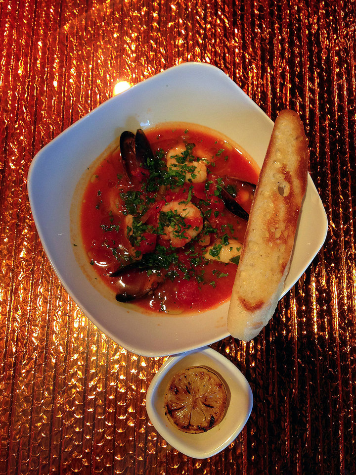 Photo - Cioppino is a dish created in San Francisco on the menu at the new Saturn Grill in MidTown.  DAVE CATHEY - THE OKLAHOMAN