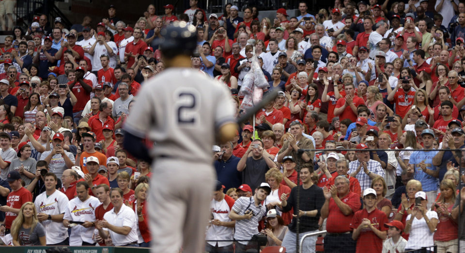 Photo - Fans give New York Yankees' Derek Jeter a standing ovation as he comes up to bat during the first inning against the St. Louis Cardinals on Tuesday, May 27, 2014, in St. Louis. (AP Photo/Jeff Roberson)